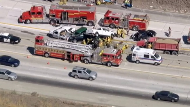 Emergency workers respond to a multi-vehicle car crash on the southbound 14 Freeway near Agua Dulce.