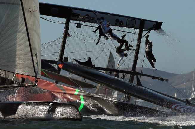 In what could have been a disastrous day for Oracle Team USA Spithill after capsizing, the team rallied to win the match racing championship. Laurence Scott reports.