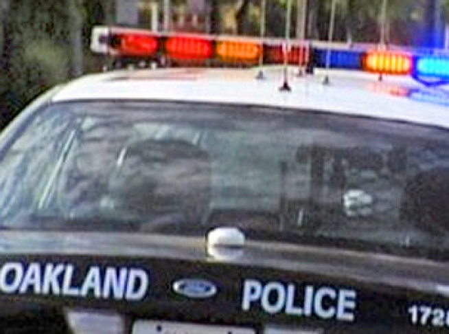 Driver Rams Oakland Officer