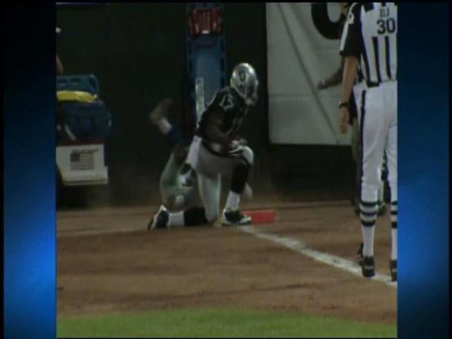Dallas Cowboys cornerback DeAngelo Smith bowls over an NBC cameraman.