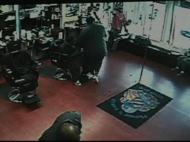 Armed gunmen storm a Miami barber shop and rapper Brisco appears to be the intended target.