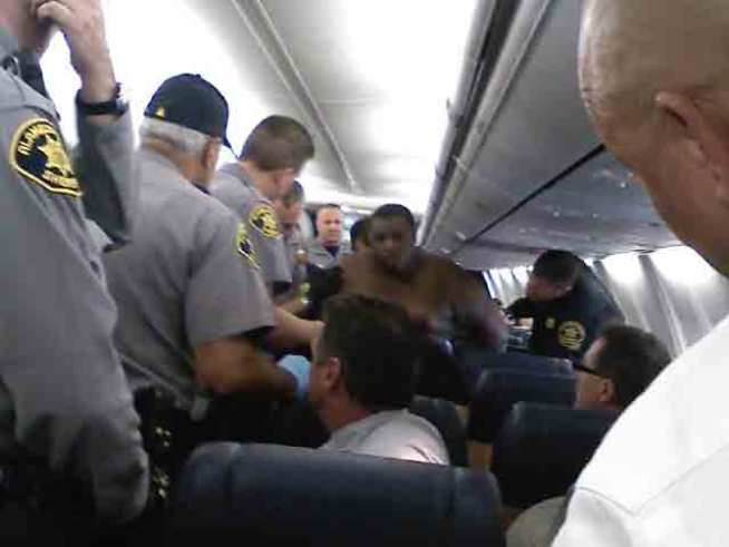 Naked Passenger Aborts Flight