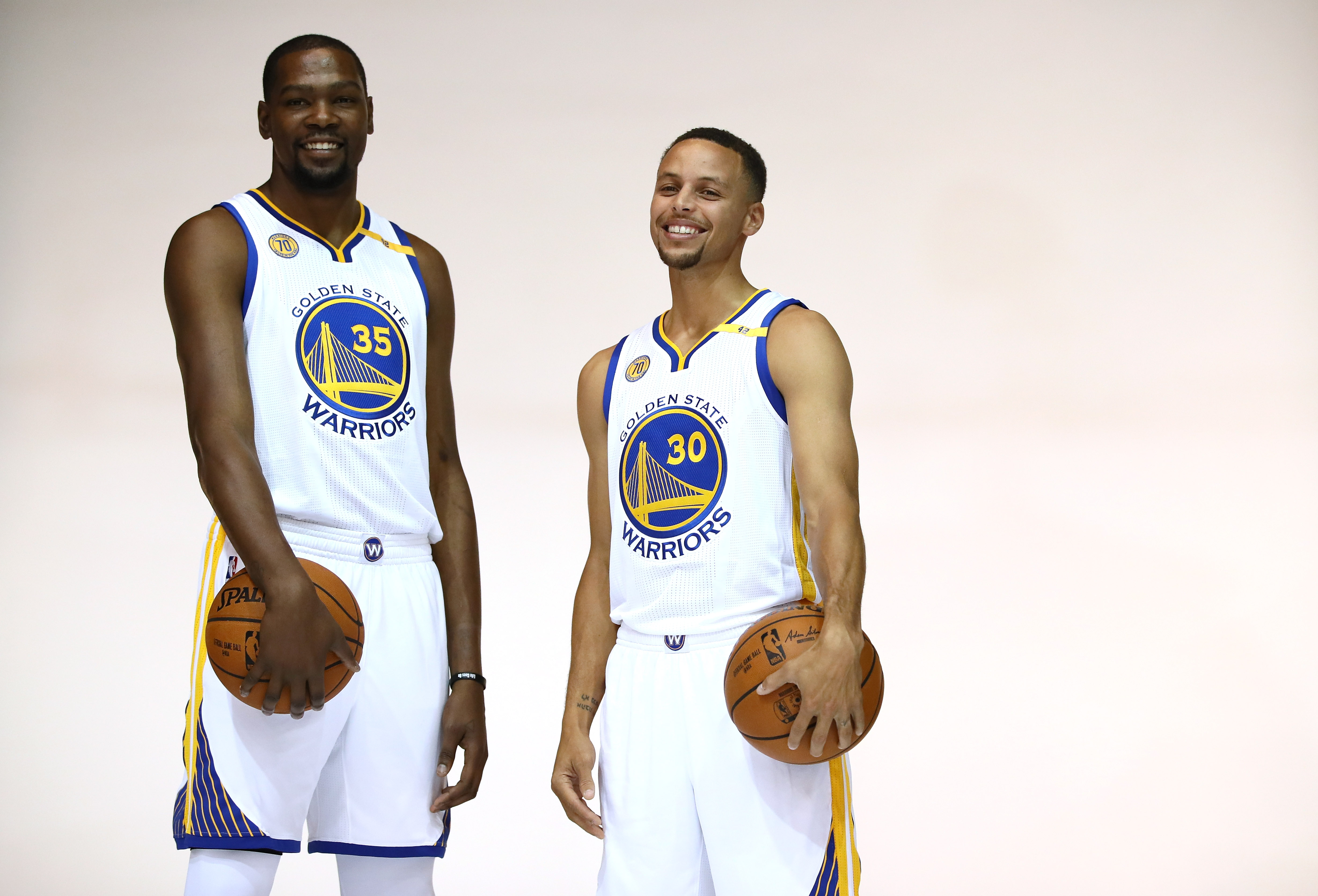 Kevin Durant  35 and Stephen Curry  30 of the Golden State Warriors pose for 71e821b91