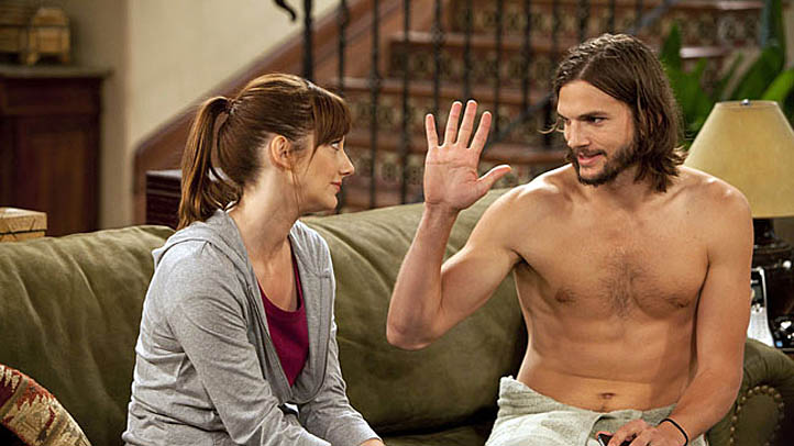 """People Who Love Peepholes"" -- Bridget (Judy Greer) Walden's ex-wife and Walden Schmidt (Ashton Kutcher) on Part Two of the ninth season premiere of TWO AND A HALF MEN, Monday, Sept. 26 (9:00-9:31 PM, ET/PT) on the CBS Television Network."
