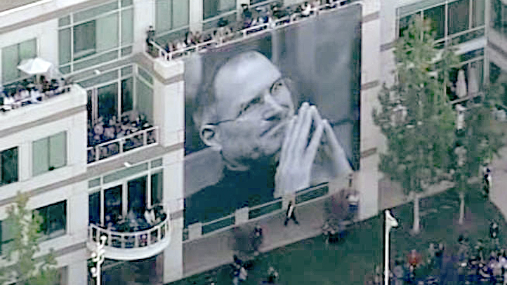Apple employees gathered in Cupertino, Calif., for a private memorial service for Apple co-founder Steve Jobs on Oct. 19, 2011. A large pictures of Jobs were draped over Apple's buildings.